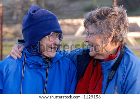 Two old friends laughing and having a good time. - stock photo