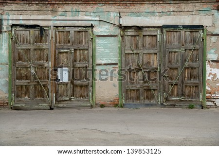 Two old garage door. - stock photo