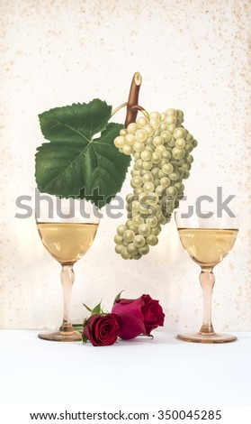 two old glasses of  white wine background grape cluster decorated, romantic moment with flowers rose,  natural light, vertical photo, - stock photo