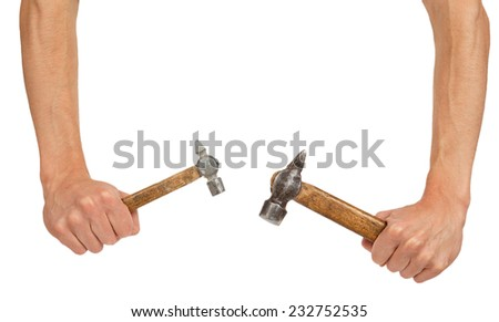 Two old hammers in hands isolated on white background - stock photo