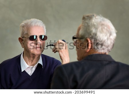 Two old man with sunglasses discussing about secret subjects - stock photo