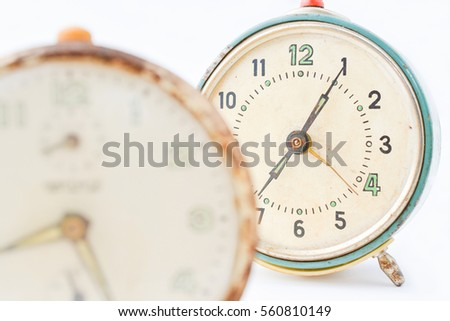 Two old manual vintage table clock islolated