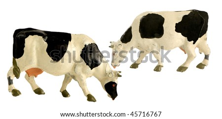 two old painted metal cows