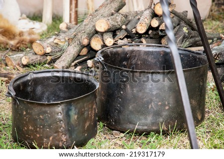 Two old pots for cooking on camping. Camping in outdoor. - stock photo