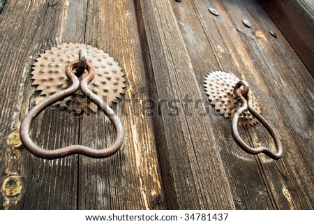 Two old rusty door handles - stock photo