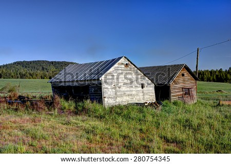 Two old sheds near Tensed, Idaho. - stock photo