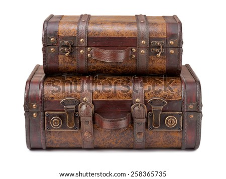 Two Old Suitcases Stacked on top of each other, isolated on white. The image is in full focus, front to back, and includes a clipping path. - stock photo