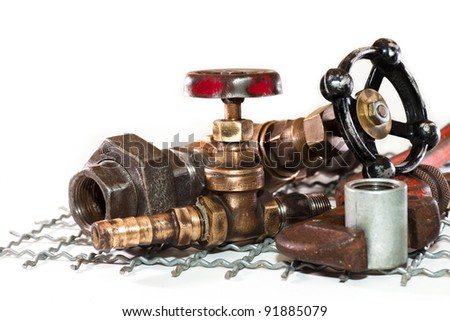 Two old tap water and tools for plumbing - stock photo