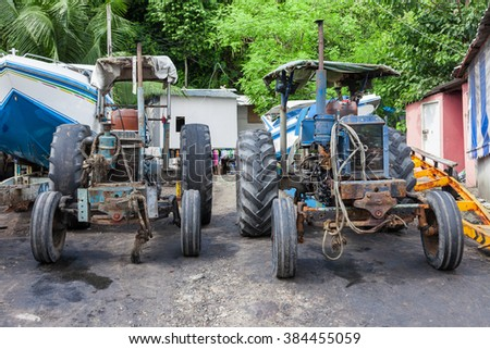 Two old tractors in Thailand - stock photo