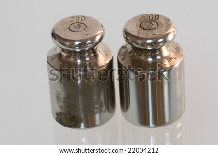 Two old weights on glass - stock photo