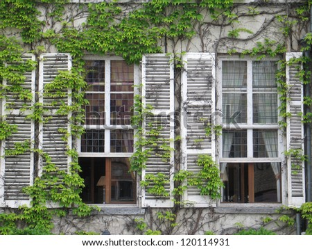 Two old windows in Bruges,  Belgium - stock photo
