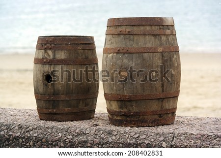 Two old wooden barrels for distilled beverage at a flea market in Brittany, France - stock photo