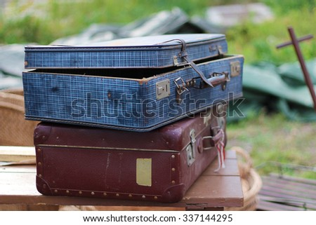 two old worn suitcases - stock photo