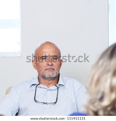 Two older persons talking - stock photo