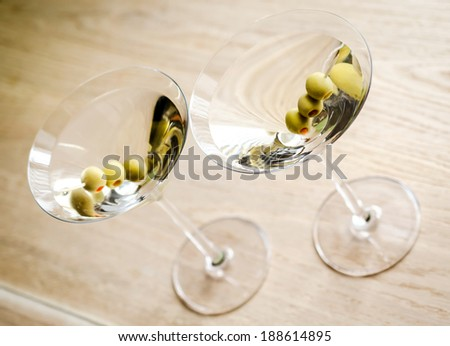 Two olive martini cocktails. The top view - stock photo