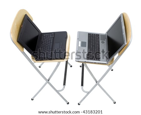 two open laptops standing on bar high chairs turned in one's side. View from top. - stock photo