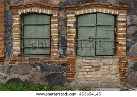 Two open windows in an old house