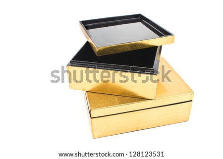 Two opened golden gift boxes isolated on  white - stock photo