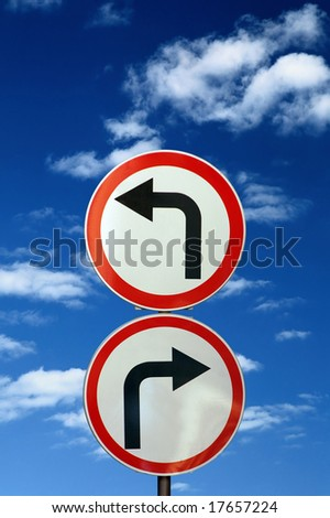 two opposite road signs against blue sky and clouds 2 - stock photo