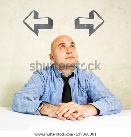 Two options. Businessman looking at arrow above him. Concept of choice, choosing between possible solutions.