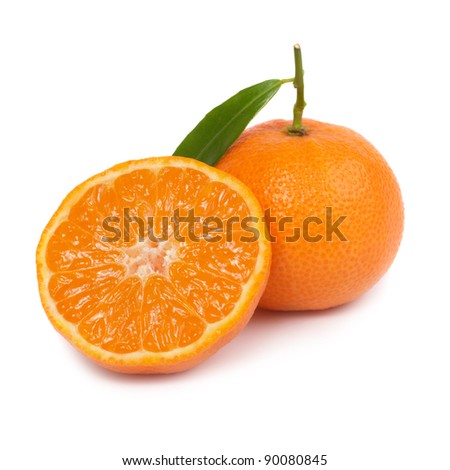 Two orange mandarins with green leaf isolated on white background - stock photo