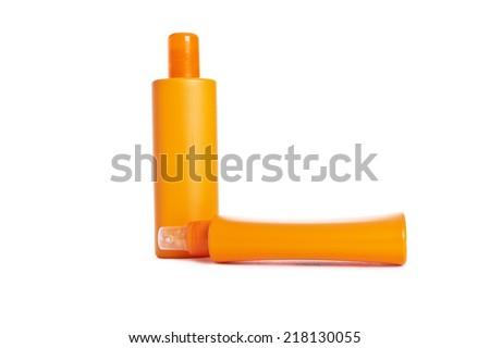 Two orange plastic bottles isolated on white - stock photo