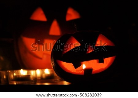 two orange pumkins in Halloween with candle