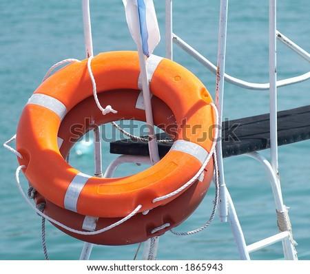 two orange ring-buoy - stock photo