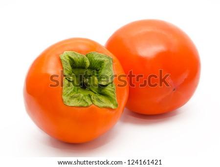 Two orange ripe persimmon isolated on white background - stock photo