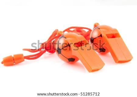 Two orange soccer whistles isolated on white background - stock photo