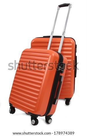two orange suitcase isolated on white background - stock photo
