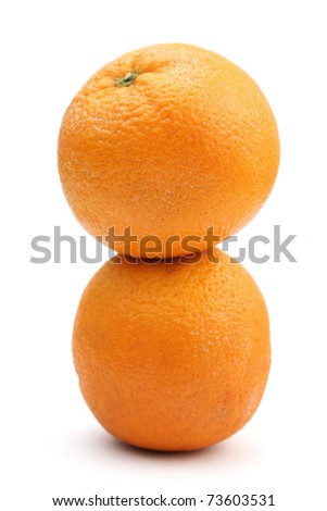 Two oranges stacked together isolated over white background.