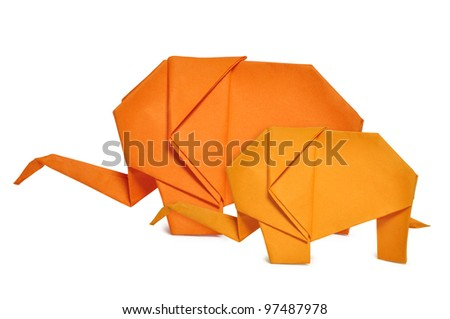 Two origami elephants from orange paper isolated on white
