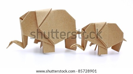 two origami elephants recycle paper - stock photo