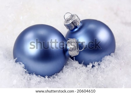 Two ornaments and snow