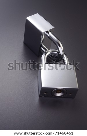 Two padlocks which are locked together. - stock photo