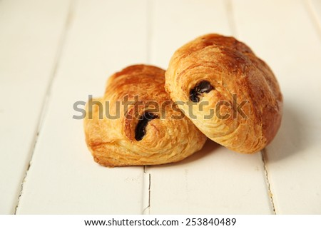 Two pain au chocolat, french pastry on white wooden background - stock photo