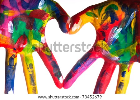 two painted colorful hands forming a heart on a white background - stock photo
