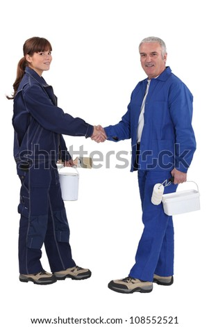 Two painter shaking hands. - stock photo