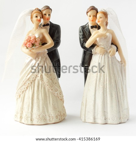 Two pair of Bride and Groom wedding cake topper