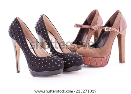 Two pair of brown and black shoes isolated on white background. - stock photo