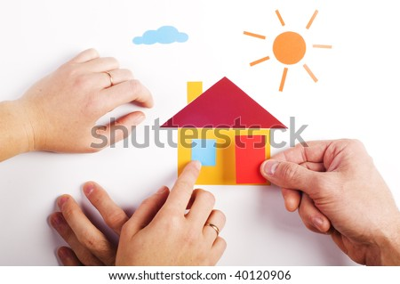 two pair of hand with color paper application of house - stock photo