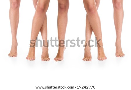 Two pairs female legs on a floor.