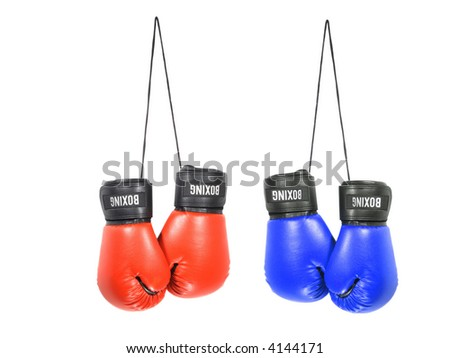 Two pairs of boxing gloves isolated on white - stock photo