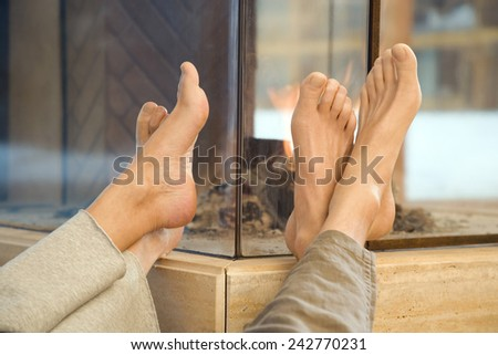 Two pairs of feet, low section - stock photo