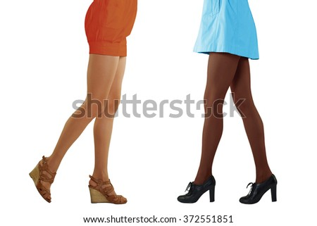 two pairs of female legs in beige and dark pantyhose