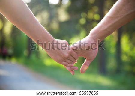 two pairs of hands in love tenderly hold together - stock photo