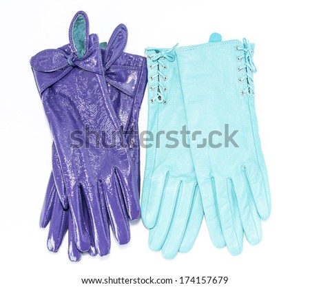 two pairs of leather gloves on an isolated background - stock photo