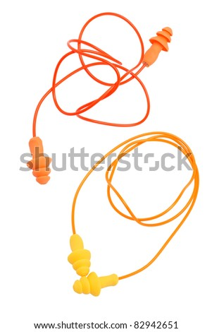 Two pairs of  rubber earplugs on white background - stock photo