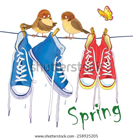 Two pairs of sneakers hanging on the rope outside on a spring day, two cute sparrows and a butterfly. White background - stock photo